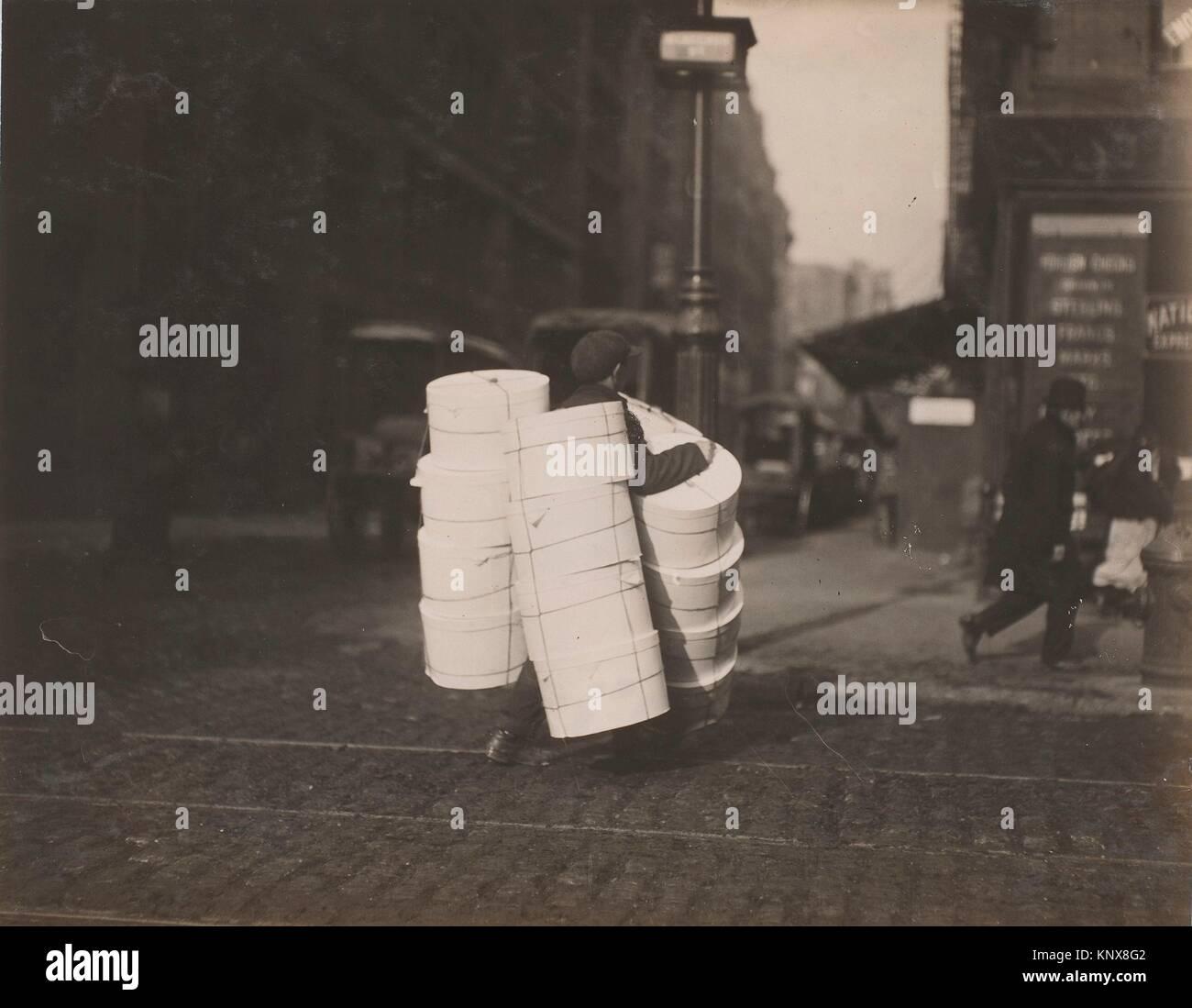 Boy carrying hats. Blee[c]ker St., N.Y. Artist: Lewis Hine (American, 1874-1940); Date: February 1912; Medium: Gelatin - Stock Image