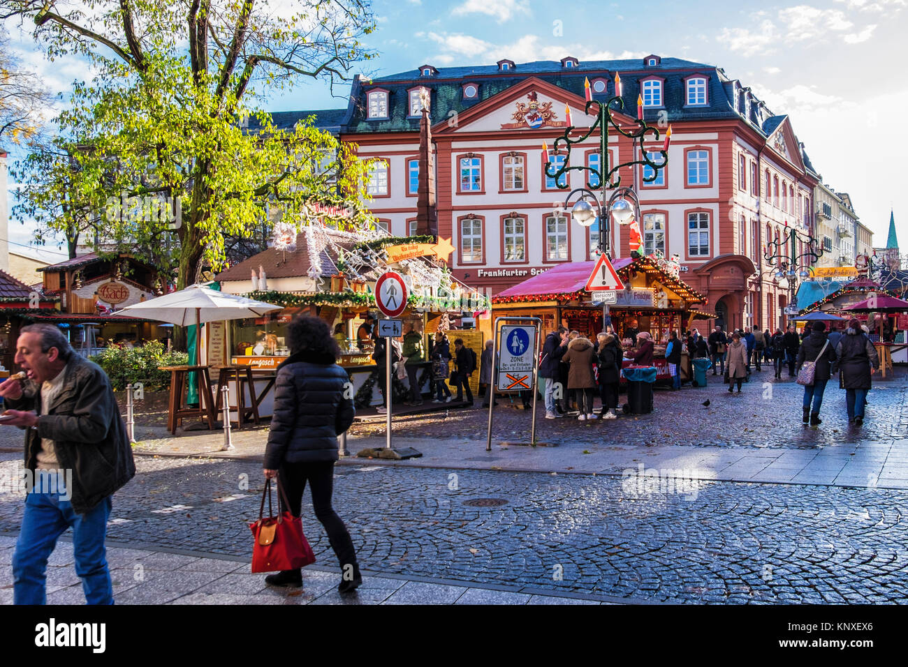 Frankfurt am Main, Germany, Liebfrauenberg square in historic old town with traditional German Christmas market in front of Baroque House of Paradise Stock Photo
