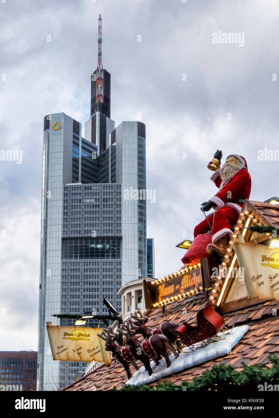 Frankfurt, Germany. Commerzbank Tower. Commerz Bank building and Xmas market stall with Father Christmas, reindeer Stock Photo