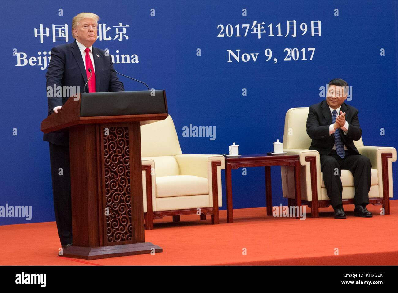 U.S President Donald Trump addresses a business event as Chinese President Xi Jinping looks on at the Great Hall - Stock Image