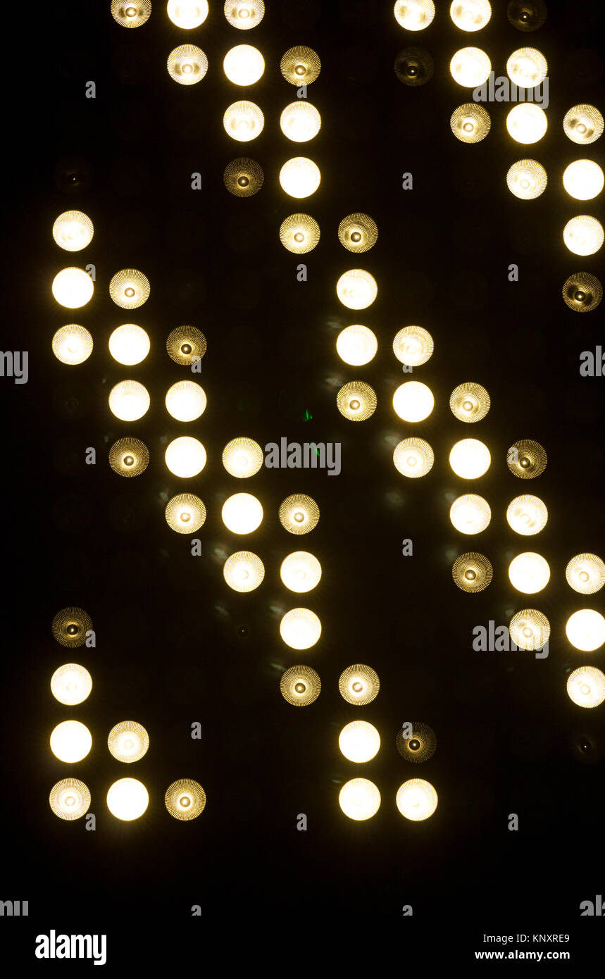 Circular white lights used to illuminate a musical concert. - Stock Image