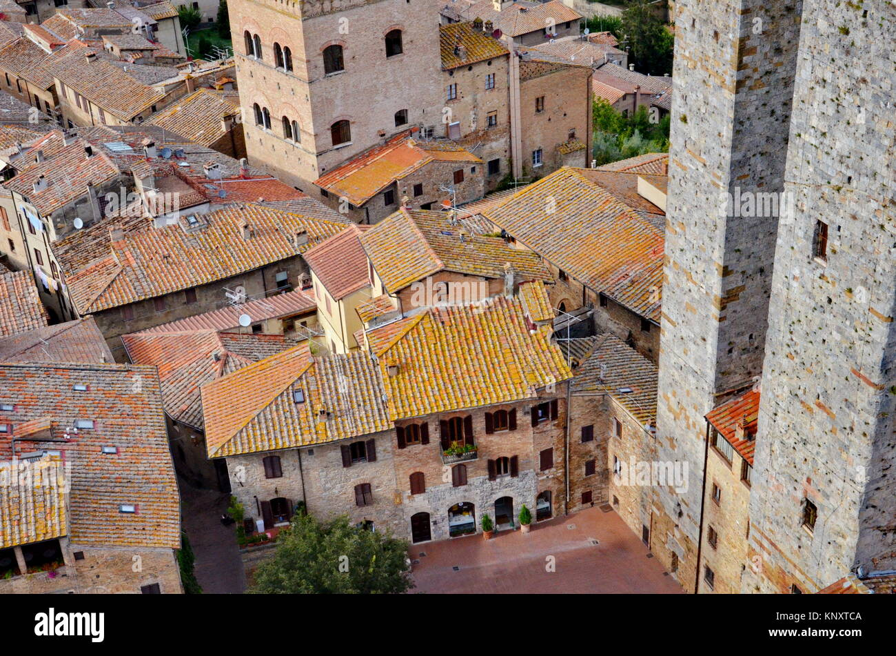 Old style rooftops and roof tiles in Italy - Stock Image