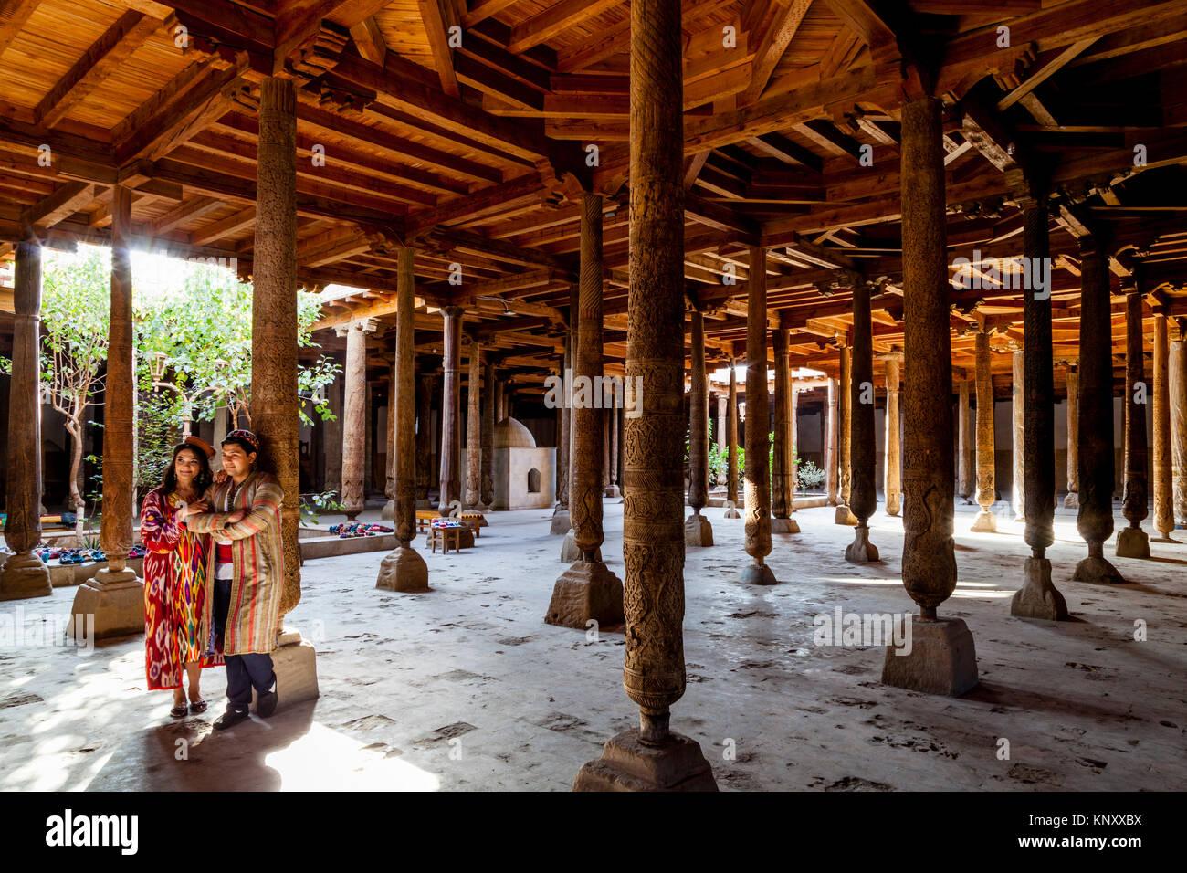 Uzbek People In Traditional Dress In The Juma Mosque, Khiva, Uzbekistan - Stock Image