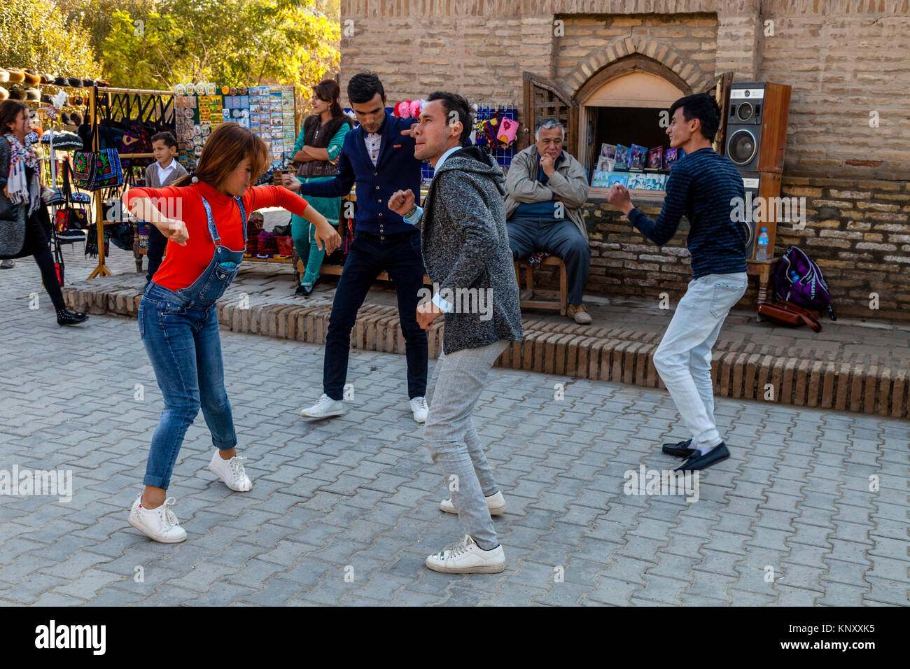 Uzbek People Dancing In The Street, Khiva, Uzbekistan - Stock Image