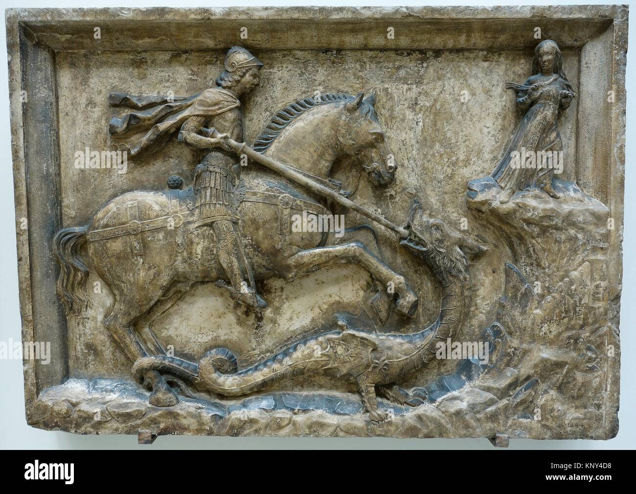 St George and the Dragon Flanked by the Dandolo Arms. Italy. Venice. Istrian stone. About 1500. The Victoria and - Stock Image
