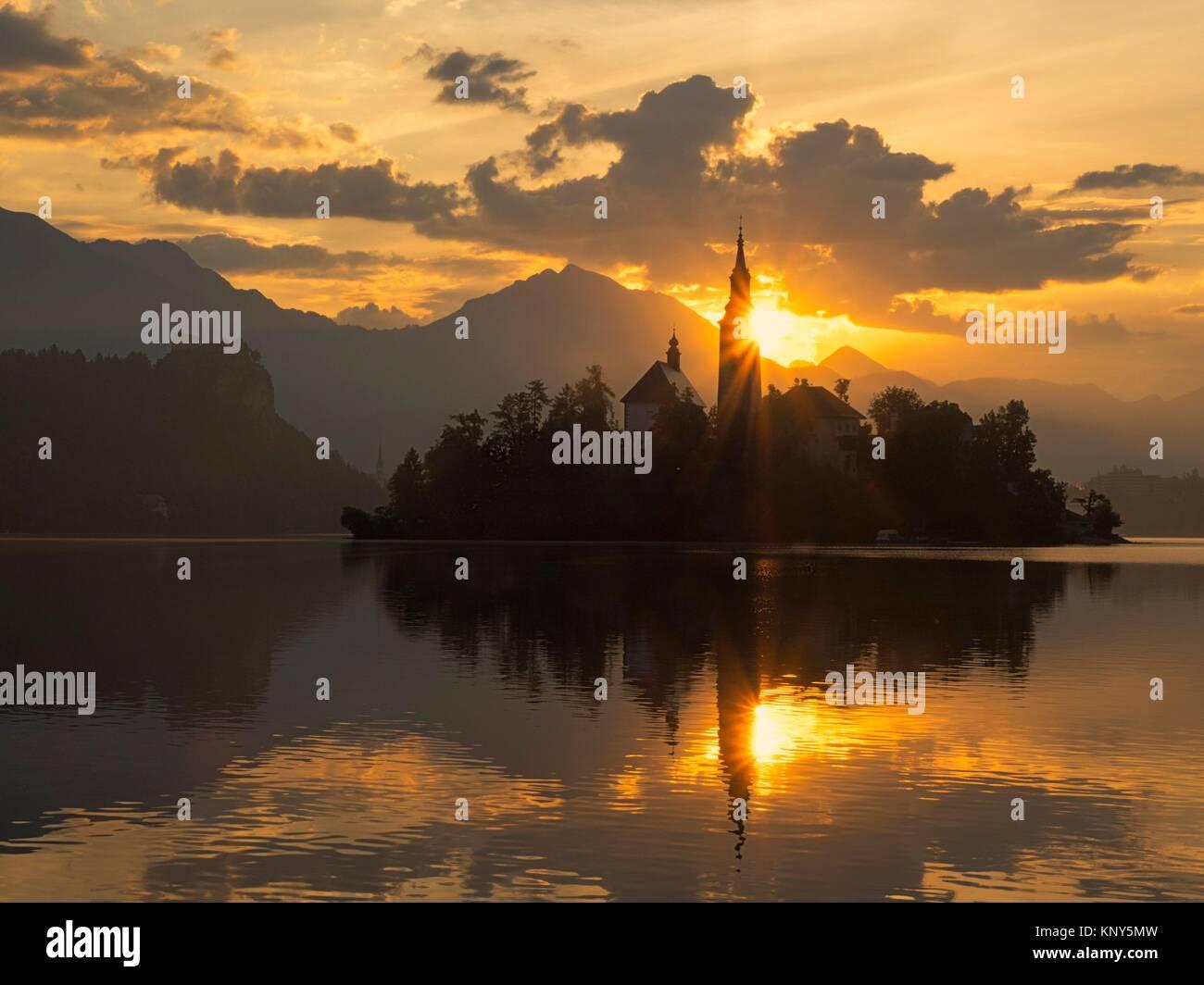 Slovenia Lake Bled Island Sunrise Starburst. - Stock Image