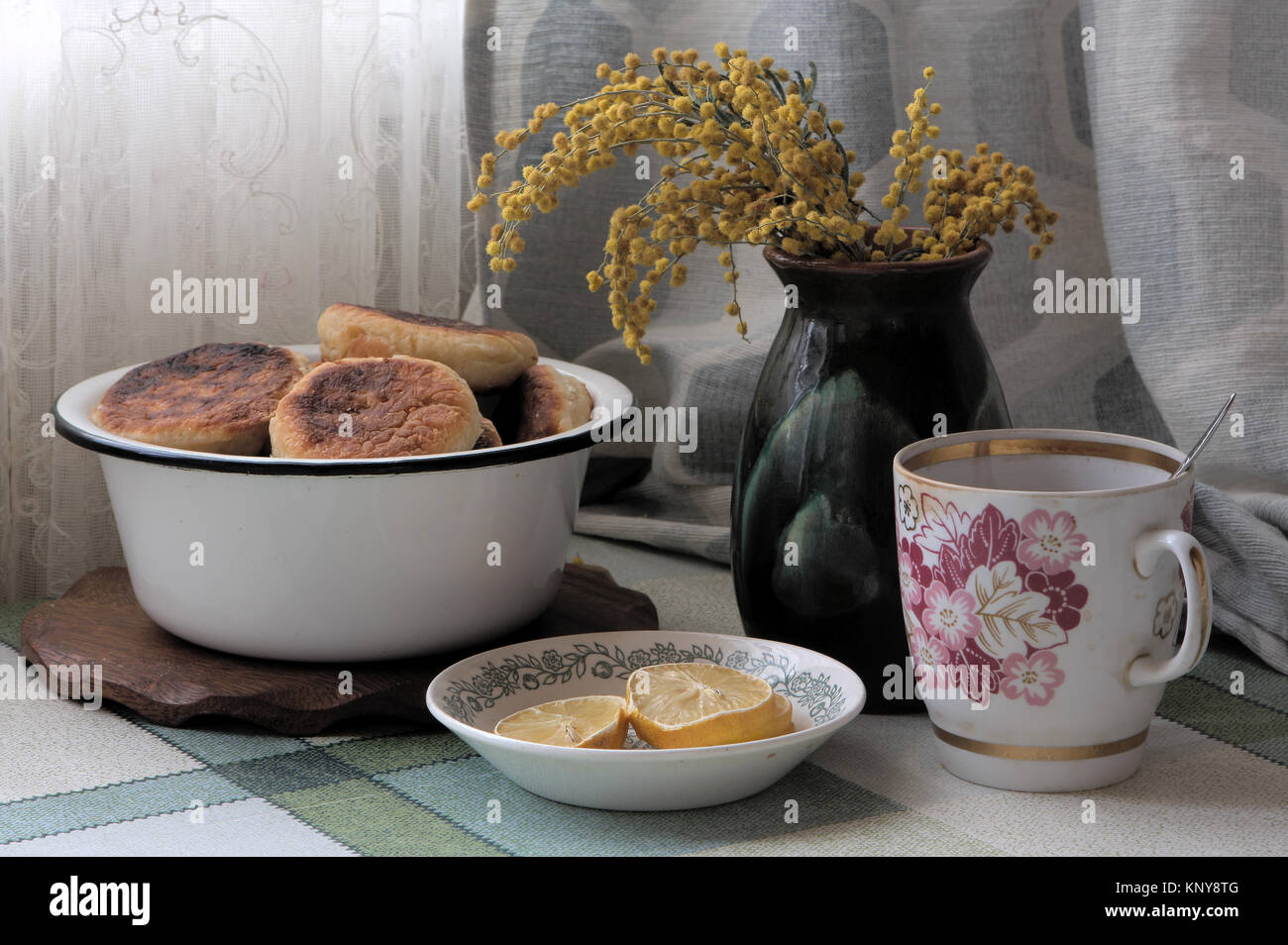 vintage still life with cheese cake and mimosa - Stock Image