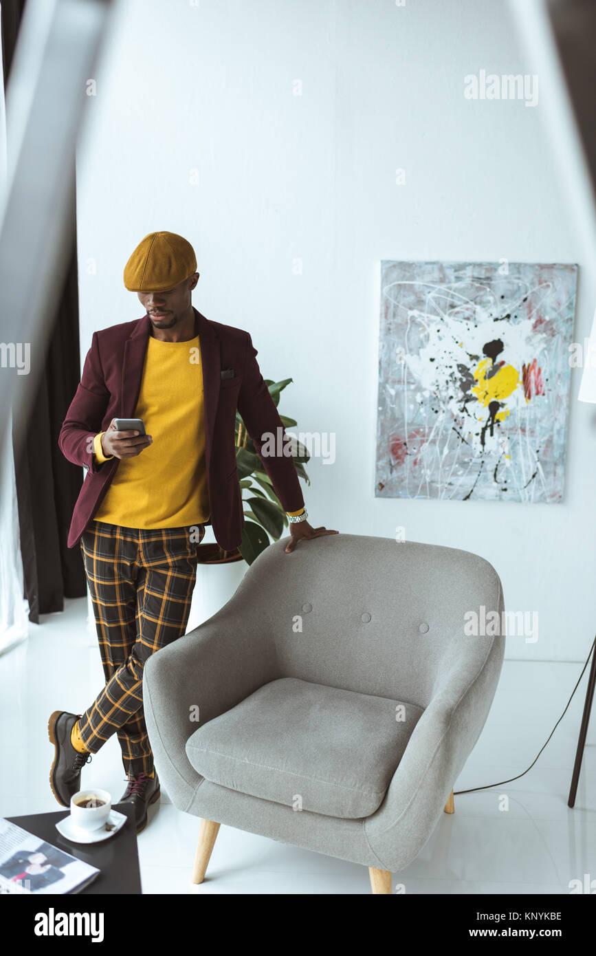 stylish businessman with smartphone - Stock Image