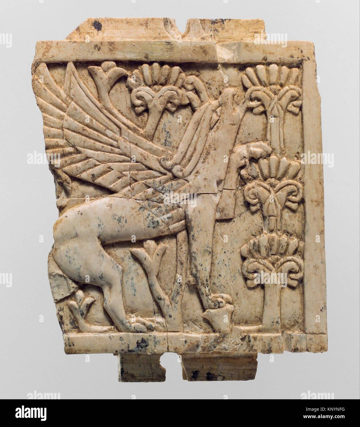 Furniture Plaque Carved In Relief With A Griffin In A Floral Landscape.  Period: Neo Assyrian; Date: Ca. 9th 8th Century B.C; Geography: Mesopotamia,