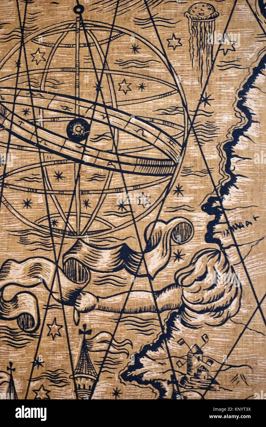 Astrolabe in a sea-related tapestry. - Stock Image
