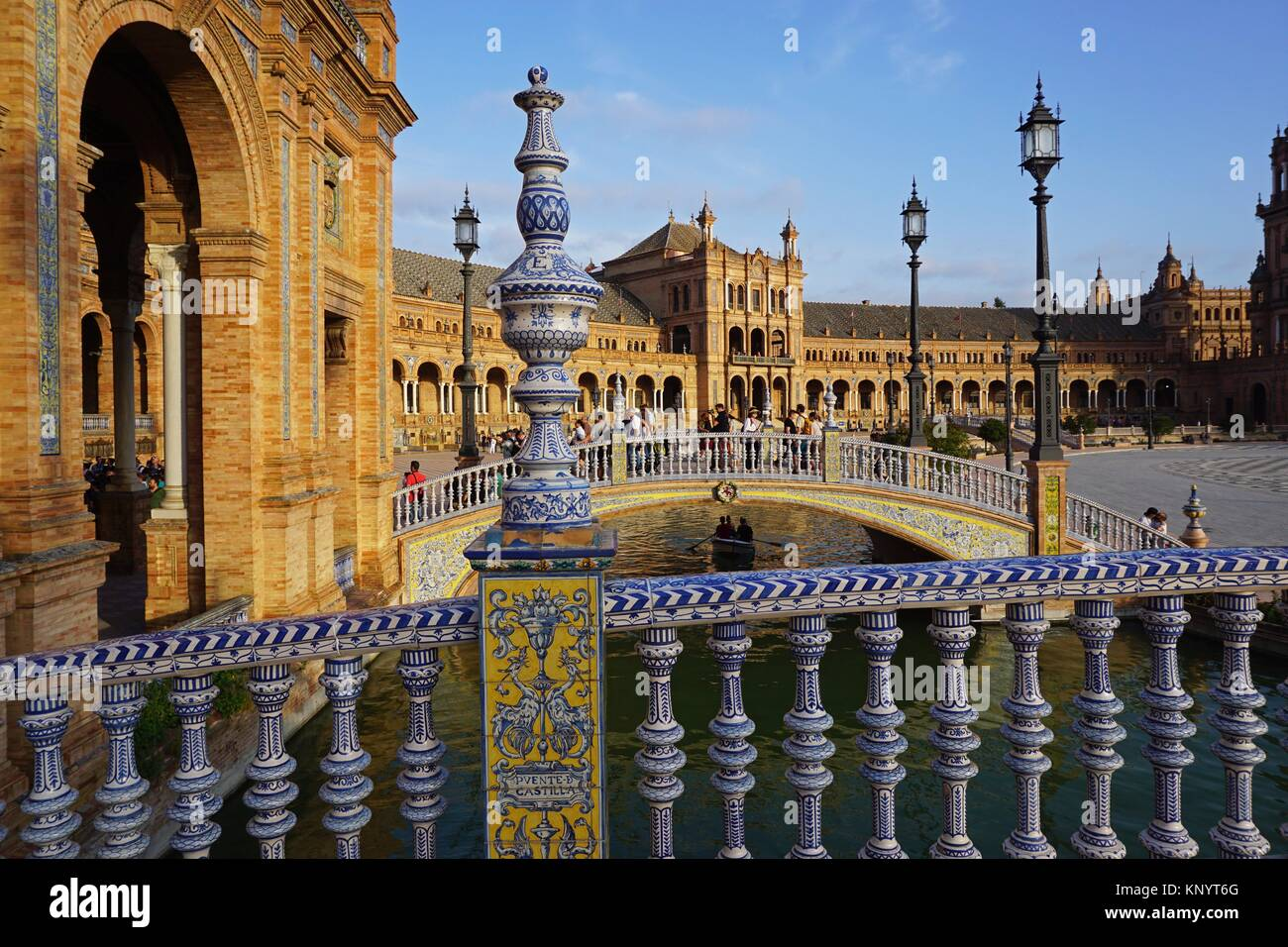 Arched buildings of a neo-renaissance palace in the shape of a semi-circular theatre and two of the four bridges - Stock Image