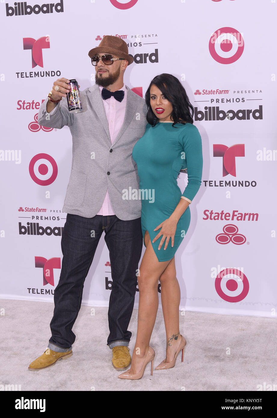 MIAMI, FL - APRIL 30:  Don Dinero and Luna Star arrives at 2015 Billboard Latin Music Awards presented by State - Stock Image
