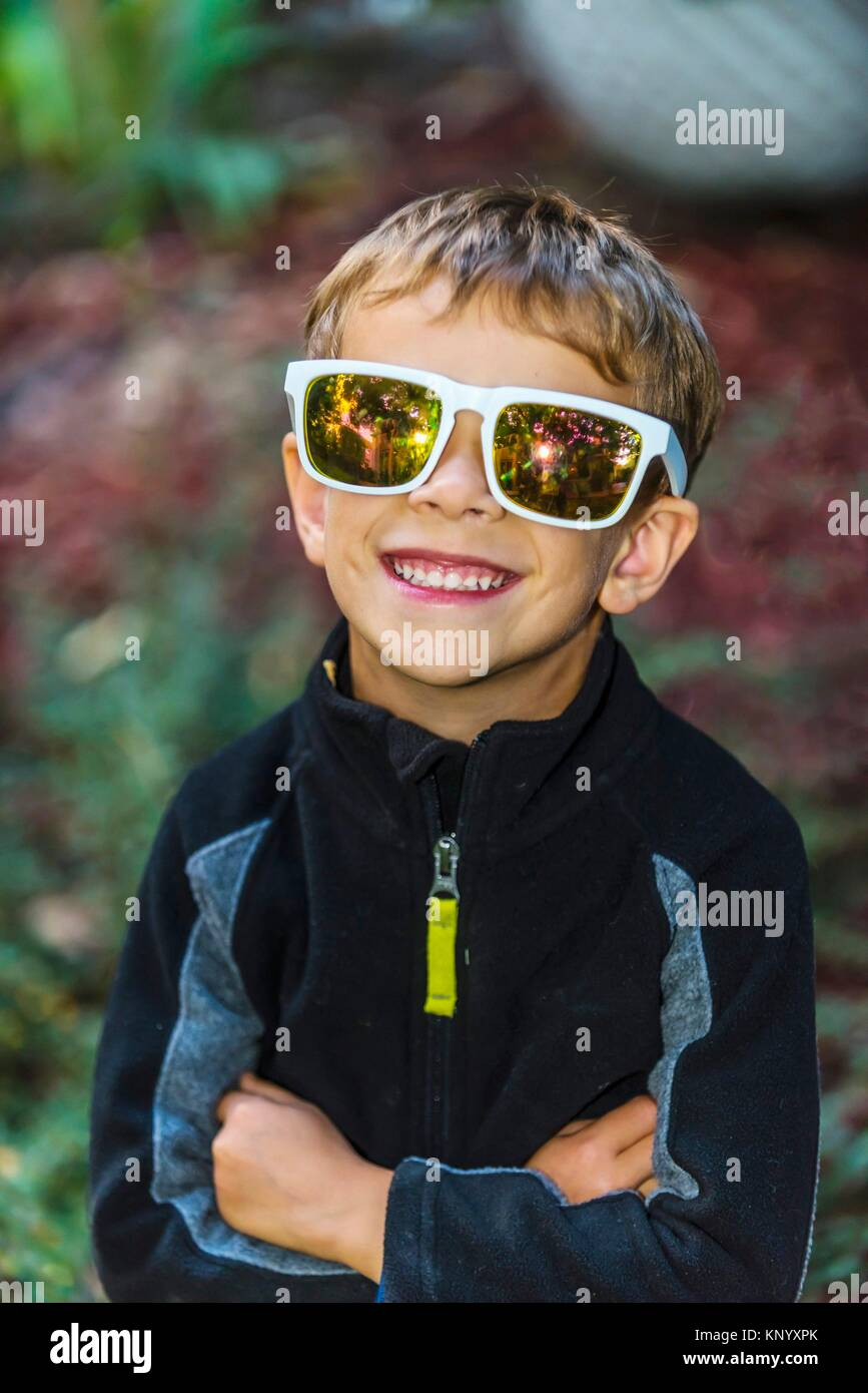 5 year old boy wearing sunglasses, Littleton, Colorado USA. - Stock Image