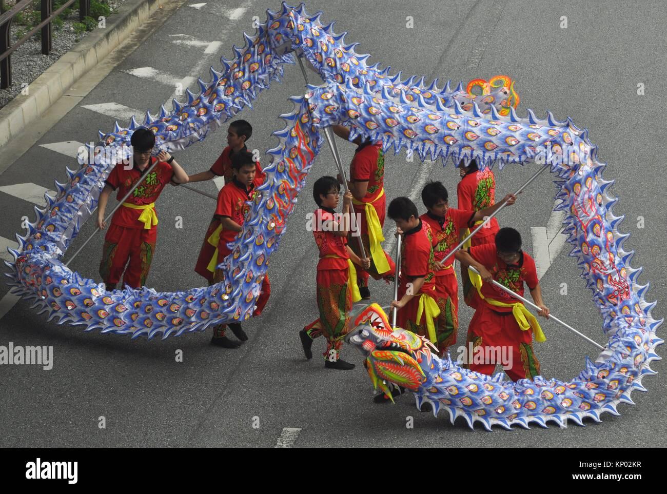 Naha, Okinawa, Japan: Dragon parade during the 6th Worldwide Uchinanchu Festival, celebrating the Okinawan emigrants - Stock Image