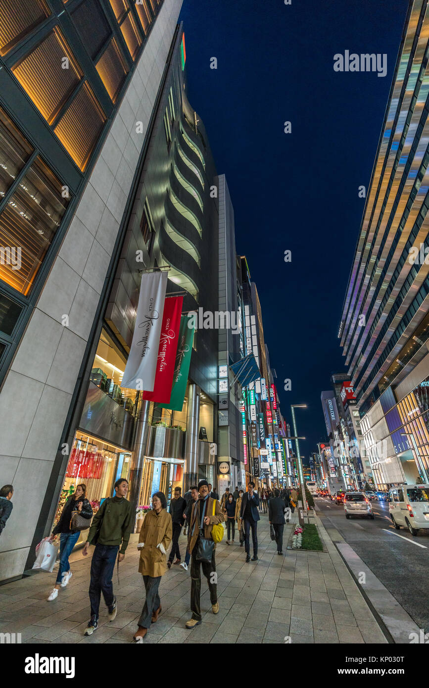 Ginza, Tokyo - December 2017 : Illuminated billboards in crowded Chuo dori street at Ginza luxurious shopping District Stock Photo