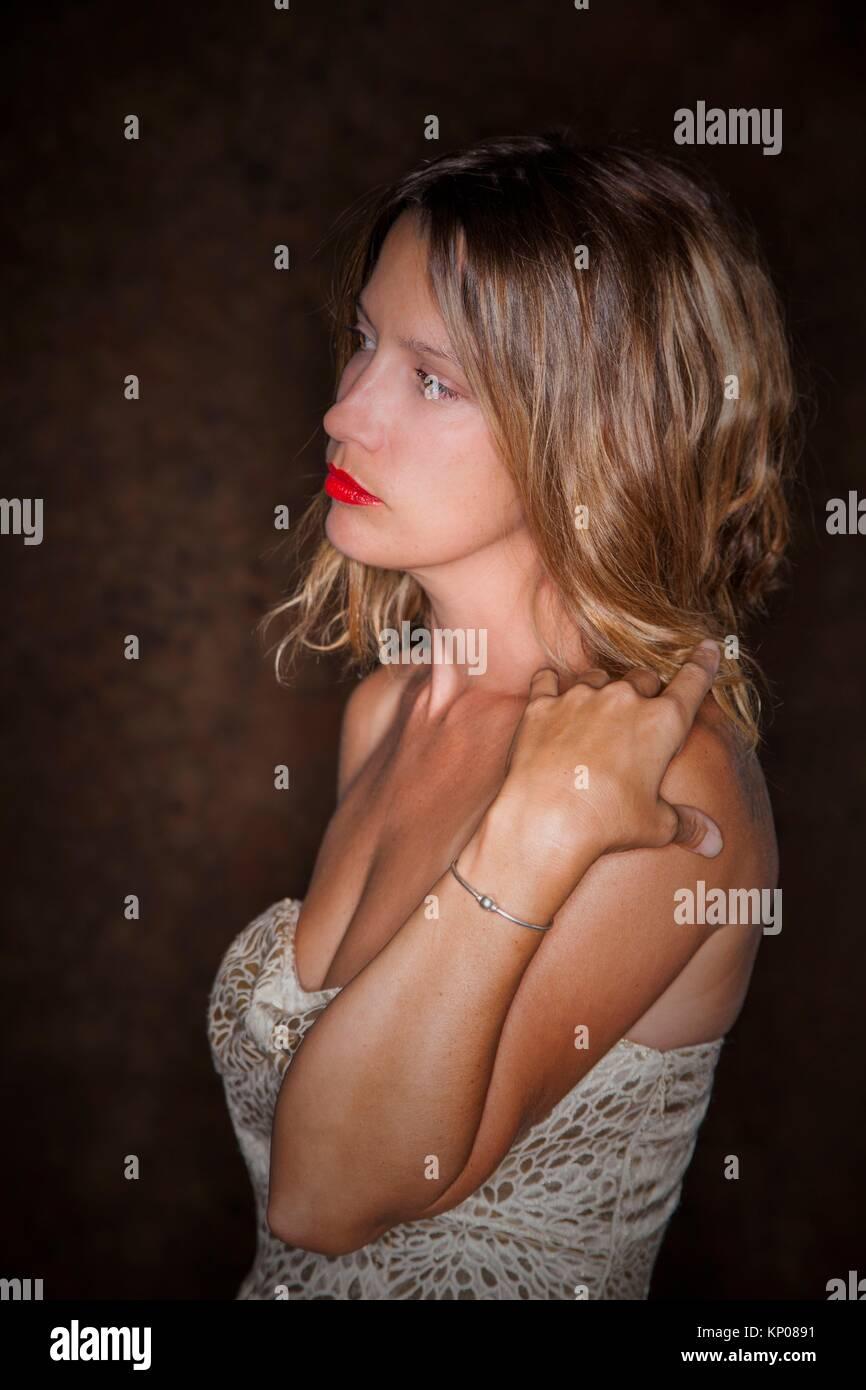 Young woman wearing a sleeveless dress. - Stock Image