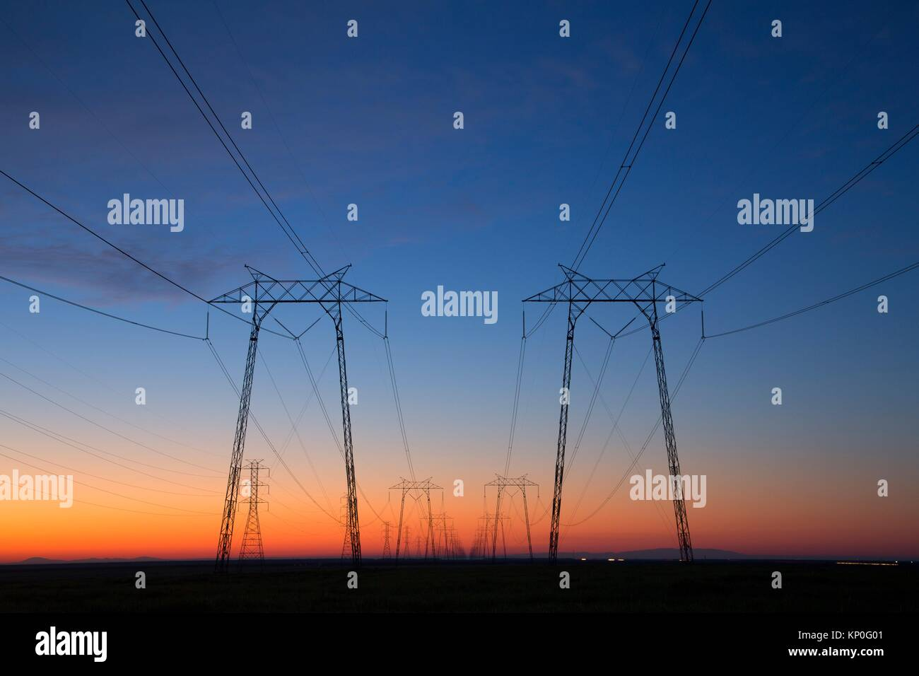 Utility lines dawn, Kings County, California. - Stock Image