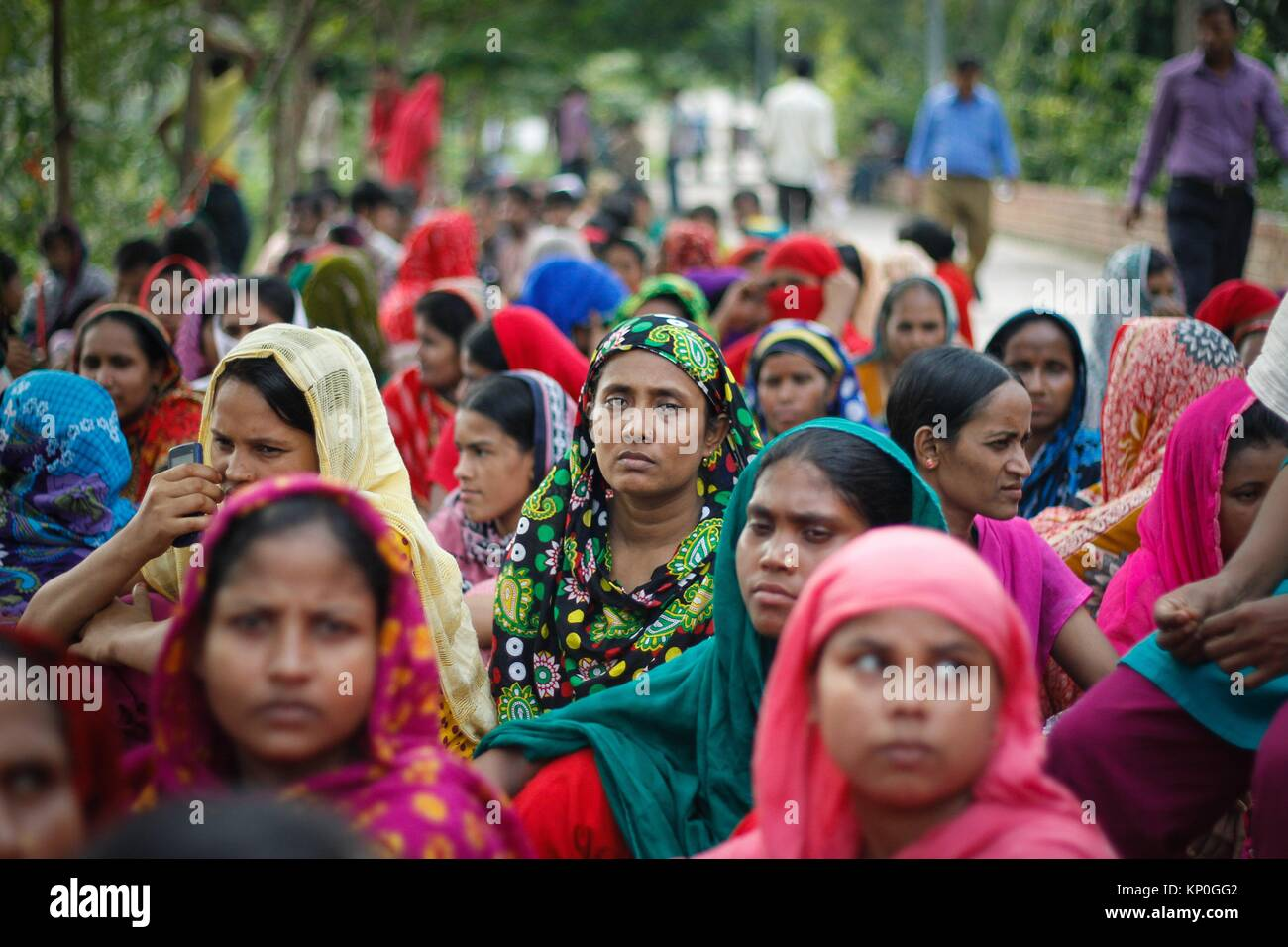 Bangladeshi garments workers attend a demonstration protest for their due salary and wages in front of National Stock Photo