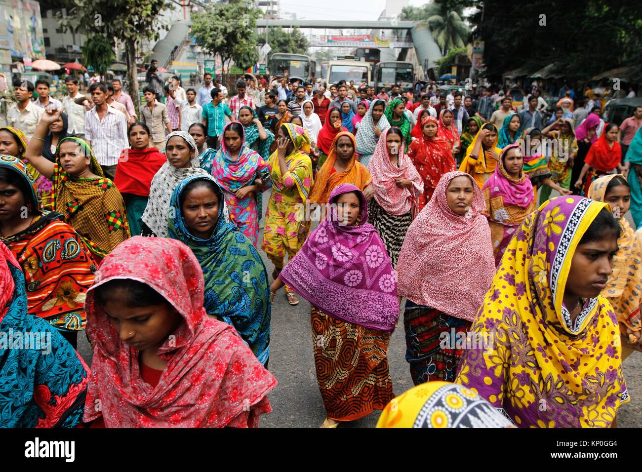 Bangladeshi garments workers attend a demonstration protest for their due salary and wages in front of National - Stock Image