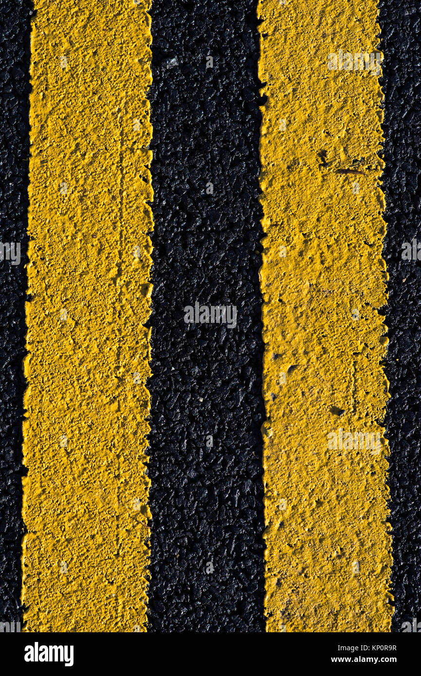 Double Yellow Line Road Marking No Parking or Traffic Waiting Zone England United Kingdom - Stock Image
