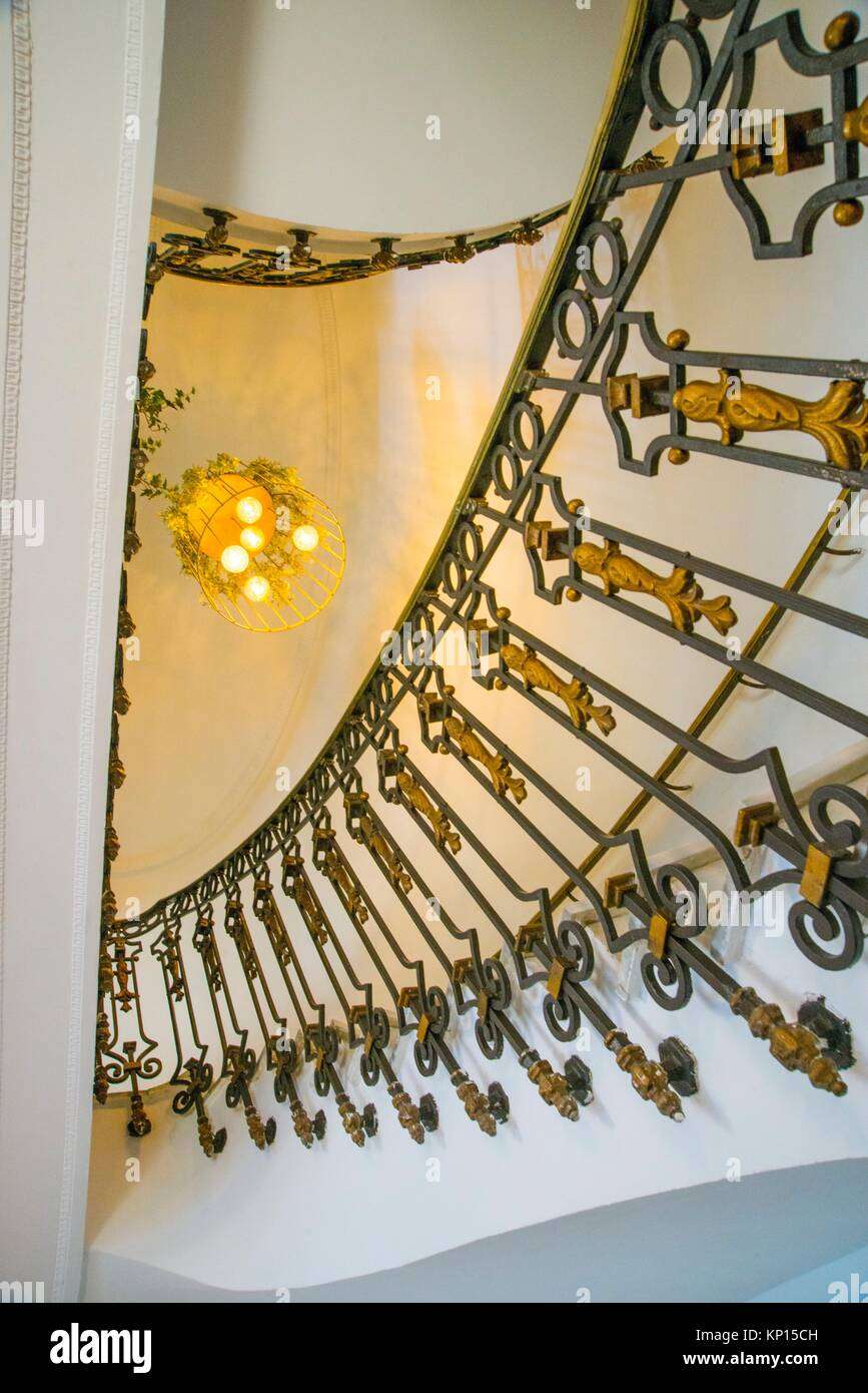 Banister of stairs, view from below. Madrid, Spain. - Stock Image