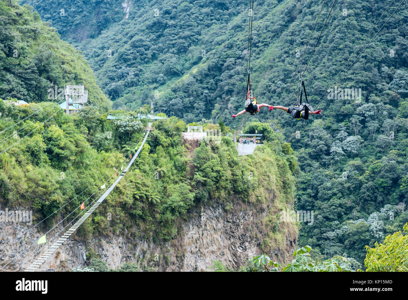 Cascades route, Banos, Ecuador - December 8, 2017: Tourists gliding on the zip line trip against the canyon - Stock Image