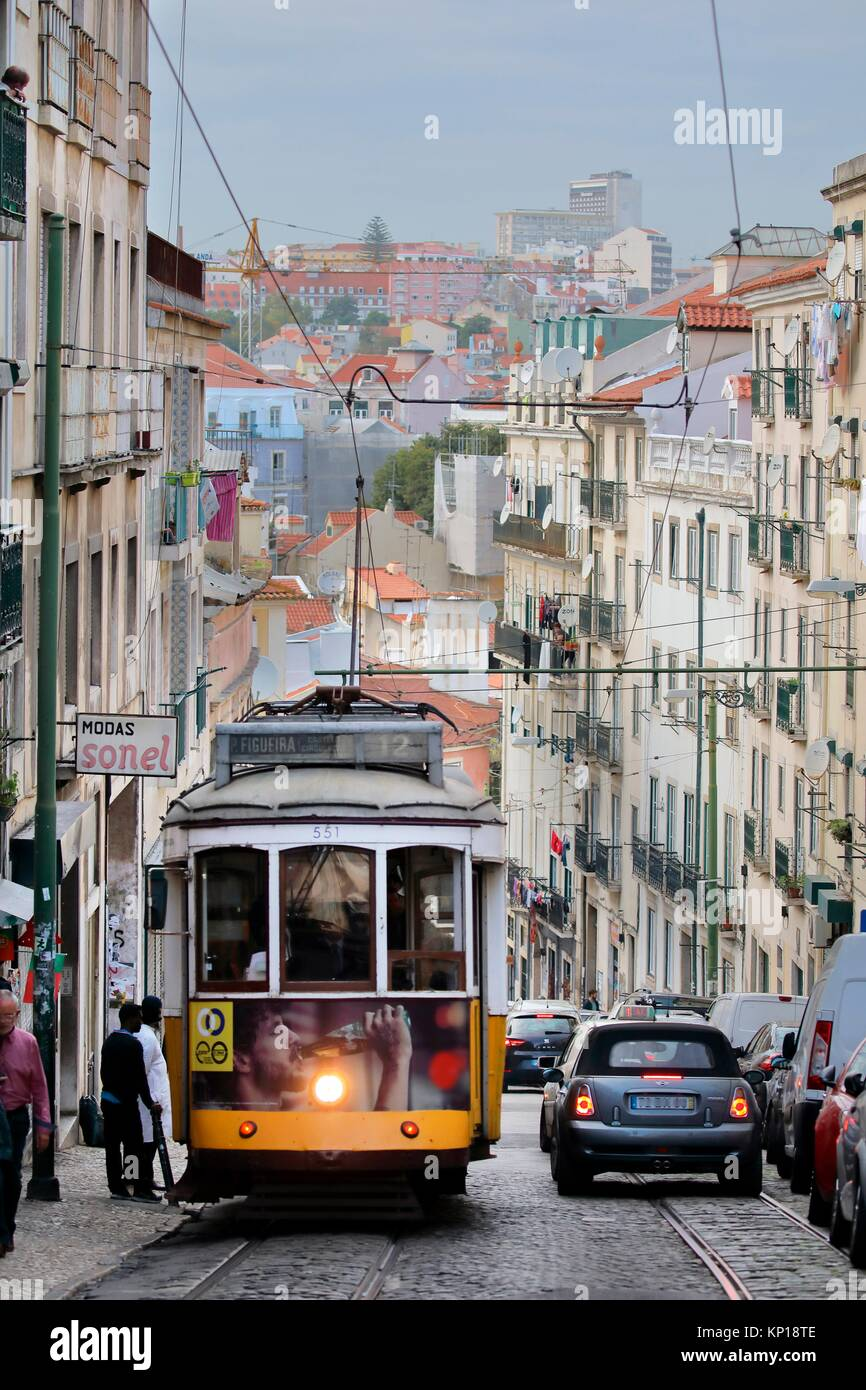 yellow vintage tramway streetcar Alfama district Lisbon Portugal. - Stock Image