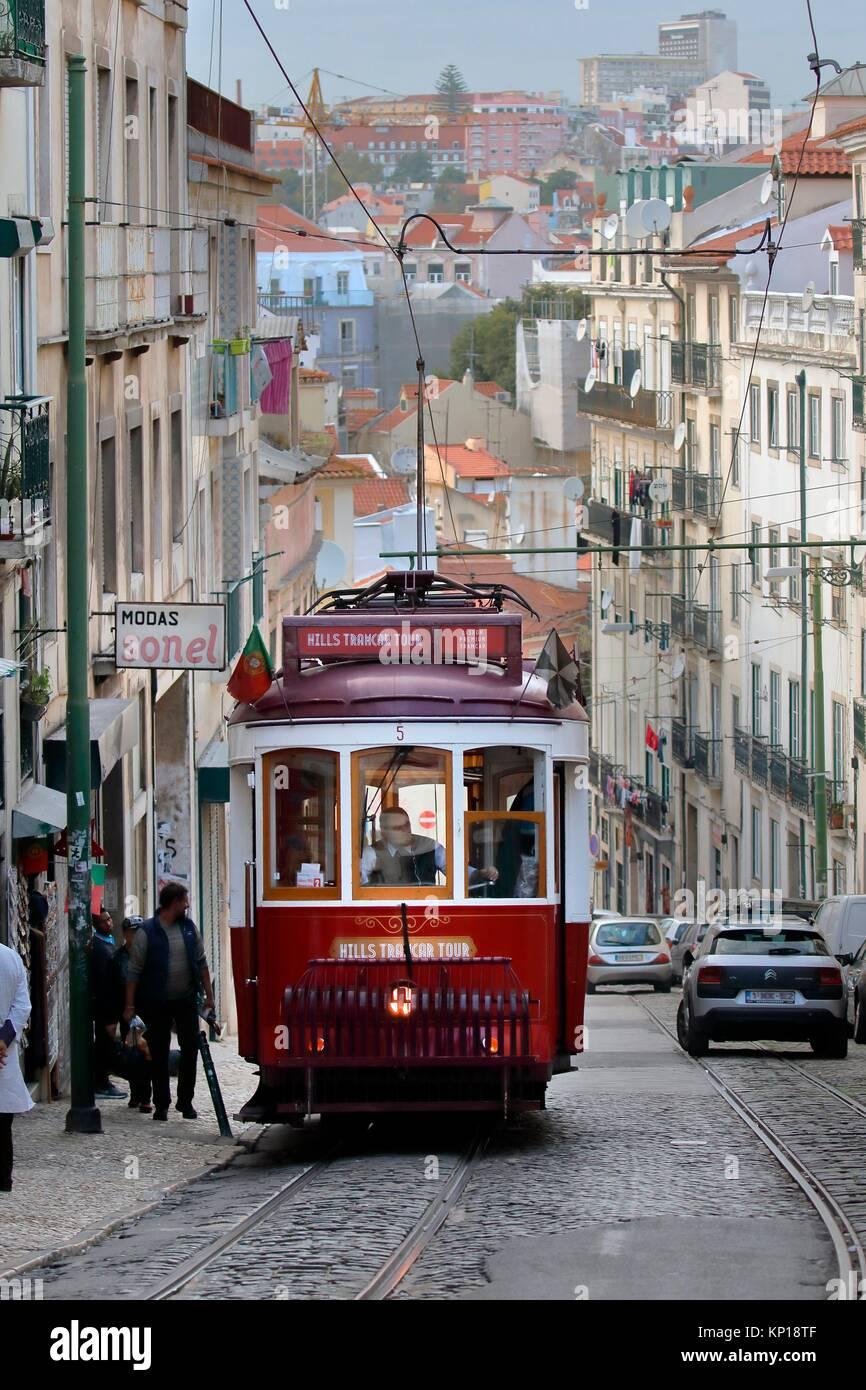 red vintage tramway streetcar Alfama street Lisbon Portugal. - Stock Image
