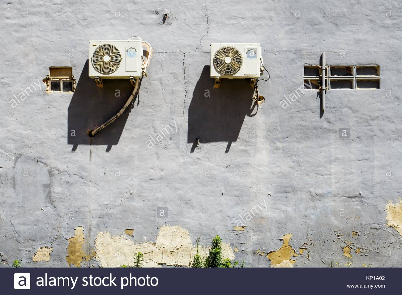 Air conditioner units outside on wall of building Stock Photo