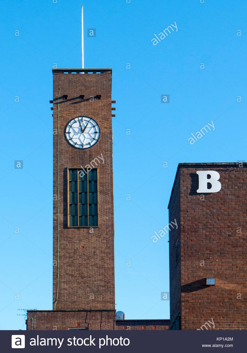 Clock tower with B from closed down bed store in Crewe, Cheshire, England, UK - Stock Image