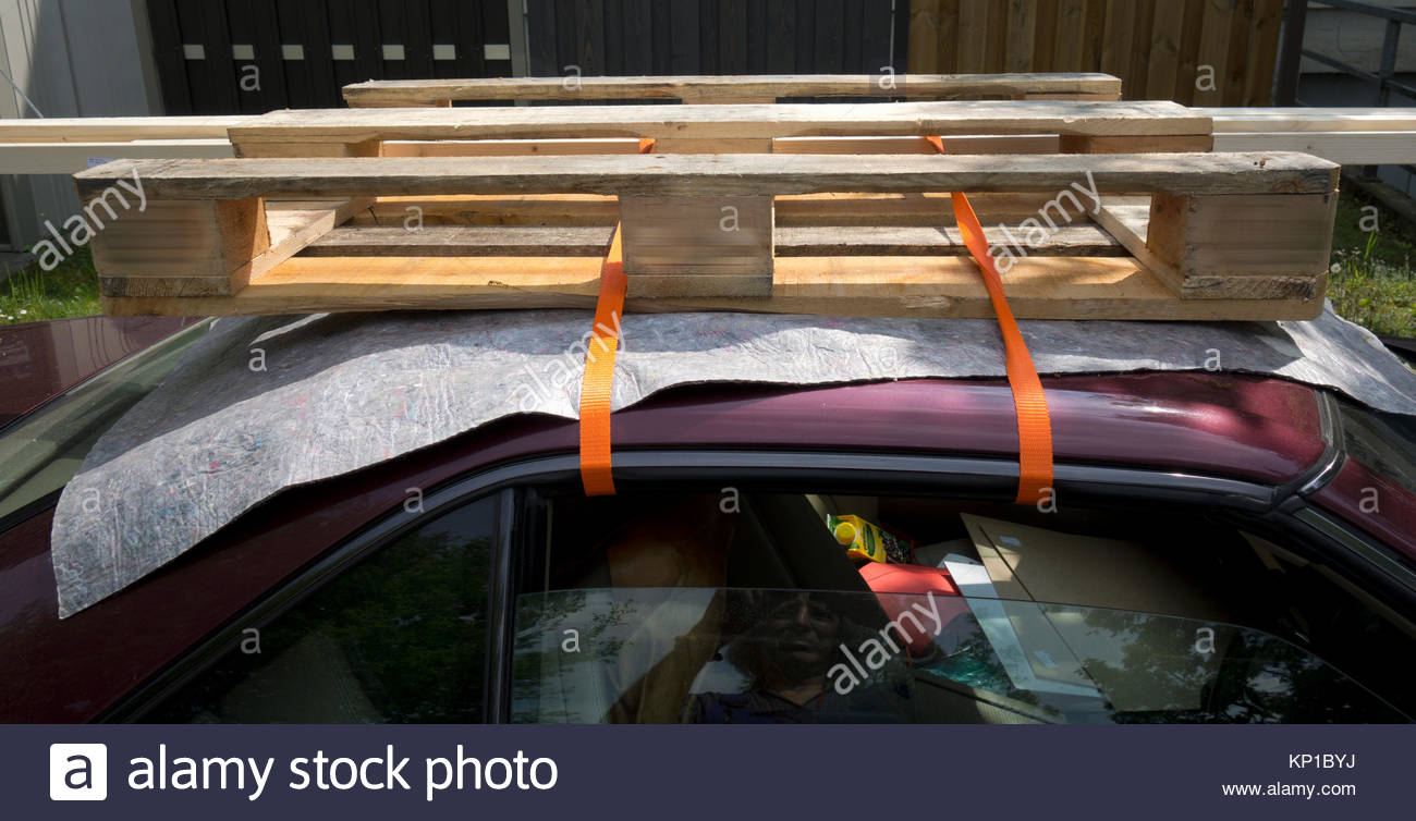 Europe Germany Bavaria View Of Sports Car Used To Transport Lumber Stock Photo Alamy