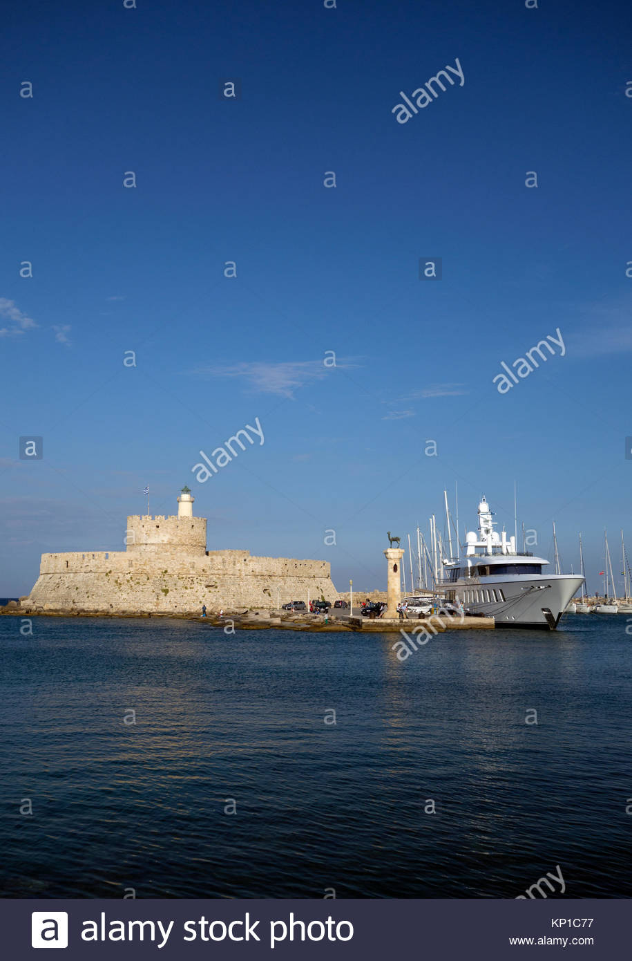 Europe, Greece, Rhodes Island, View Of Part Of Rhodes Castle With Motor Yacht In Port Stock Photo