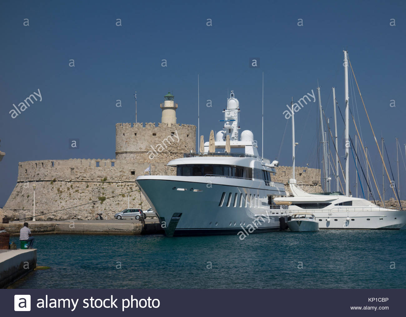 Europe, Greece, Rhodes Island, View Of Tower and Fort of Saint Nicholas, Guarded Mandraki Military Harbour, Built Stock Photo