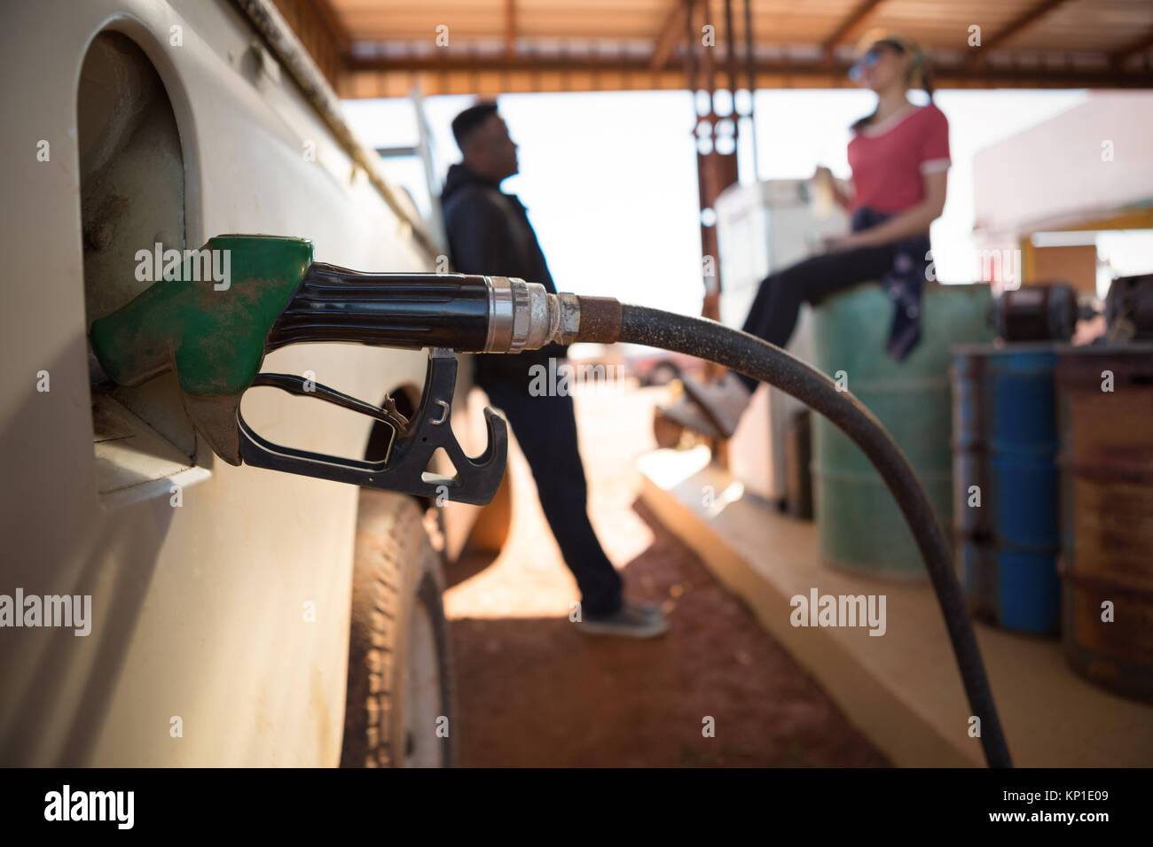 Close-up of automatic nozzles filling petrol into car tank Stock Photo