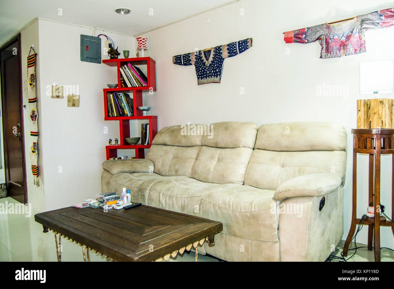 Living-room interior with antique and modern furnishings and decor, downtown Cebu, Philippines - Stock Image