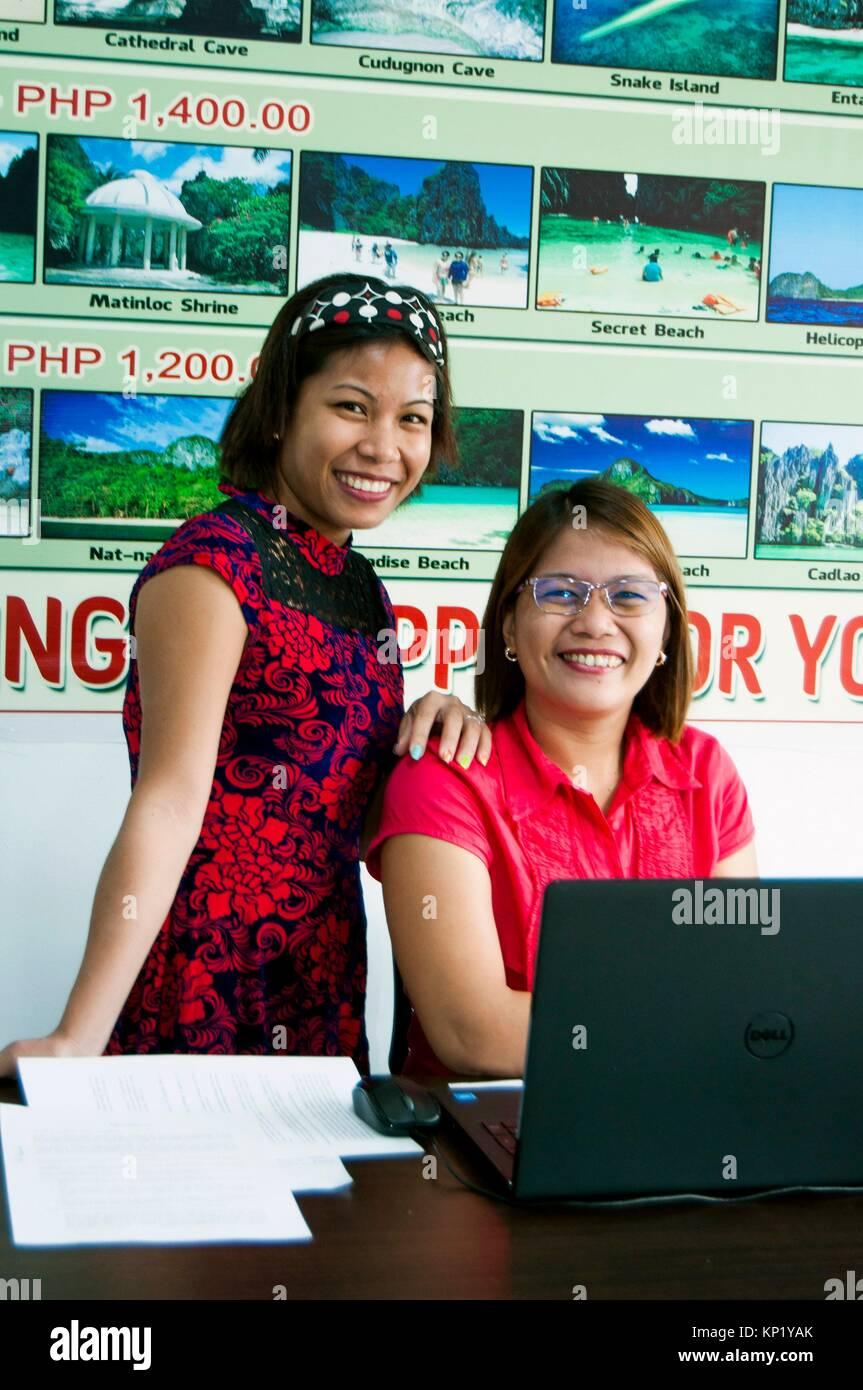 Travel agency staff members, Rizal Avenue, Puerto Princesa, Palawan, Philippines - Stock Image