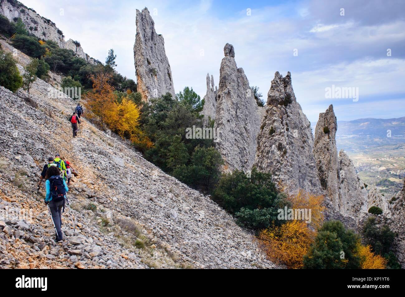 Walker walking the mountain, under the knives of the Quatretondeta Friars, Alicante, Valencia, Spain - Stock Image