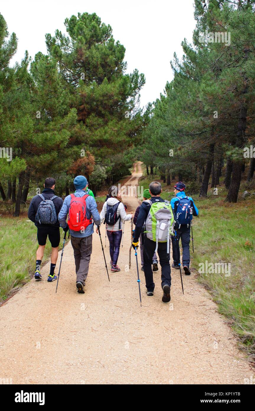 Walkers walking down a path in the mountains of Quatretondeta, Alicante, Valencia, Spain - Stock Image