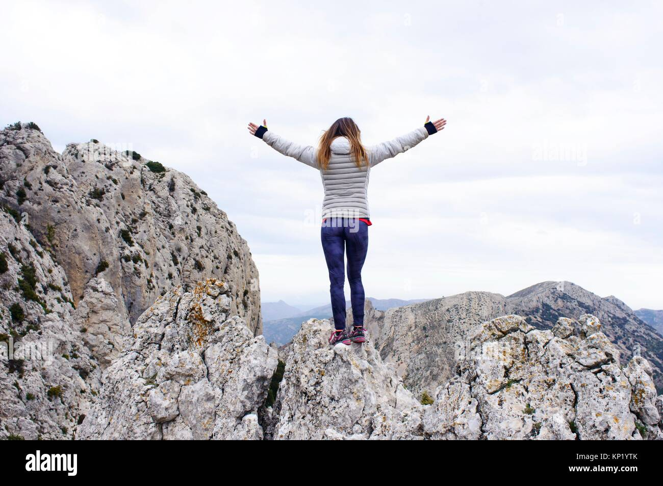 Woman on top of the mountain in Quatretondeta, Alicante, Valencia, Spain - Stock Image