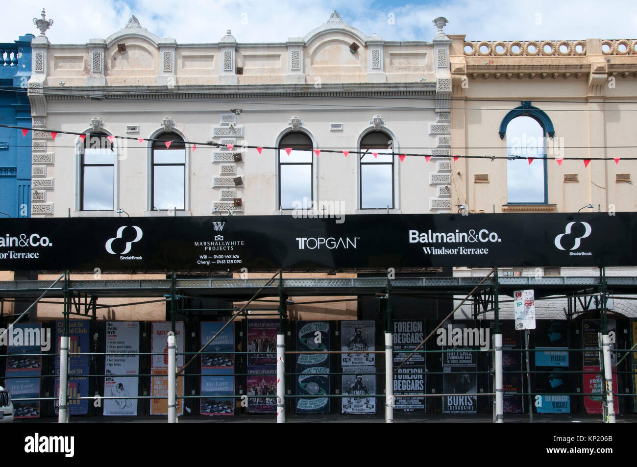 Urban renewal underway in inner-city Melbourne, Australia. A Victorian-era row of terraces survives only as a facade. - Stock Image