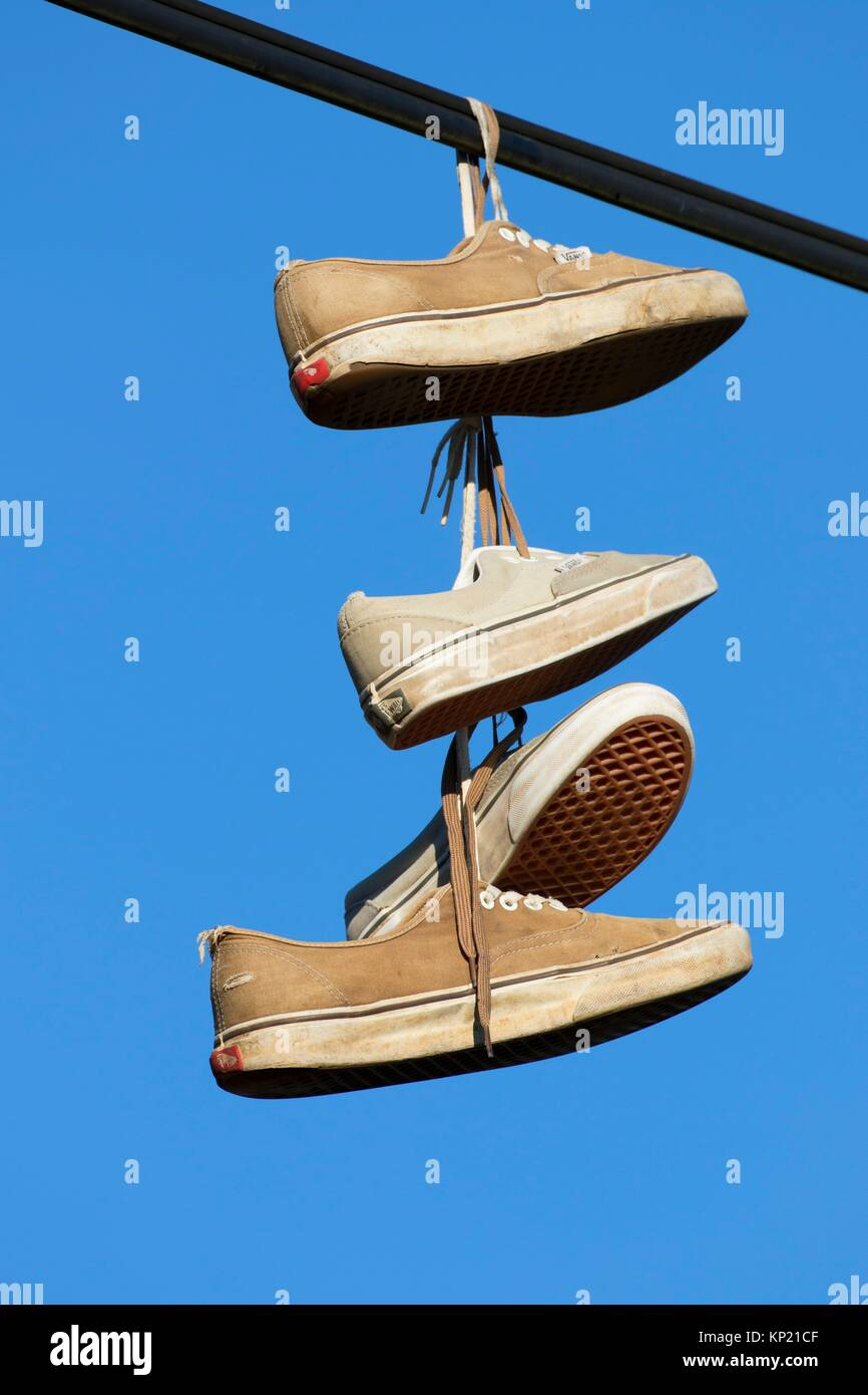 Sneakers hanging on wire, Linn County, Oregon. - Stock Image