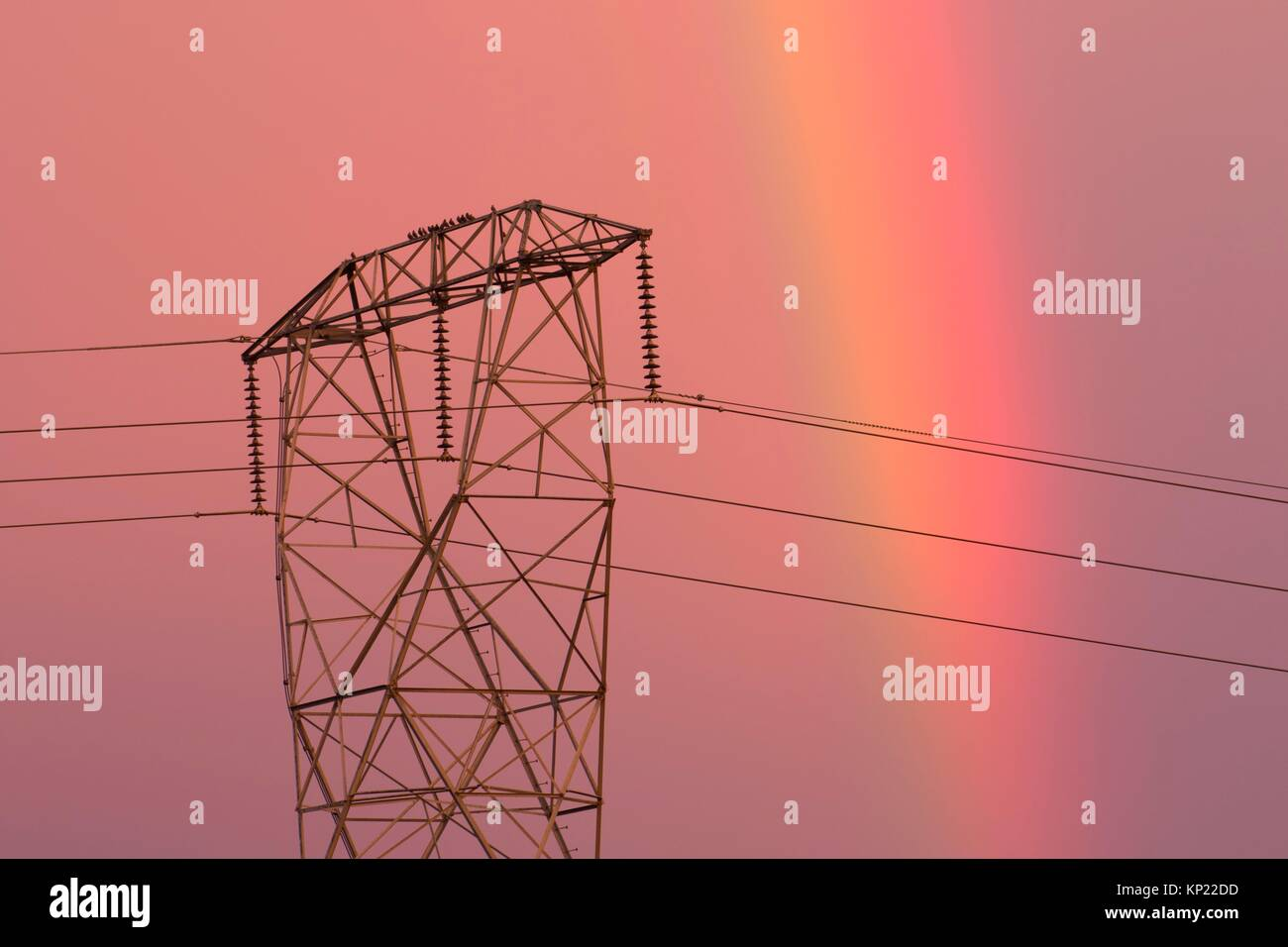 Utility tower with rainbow, Marion County, Oregon. - Stock Image