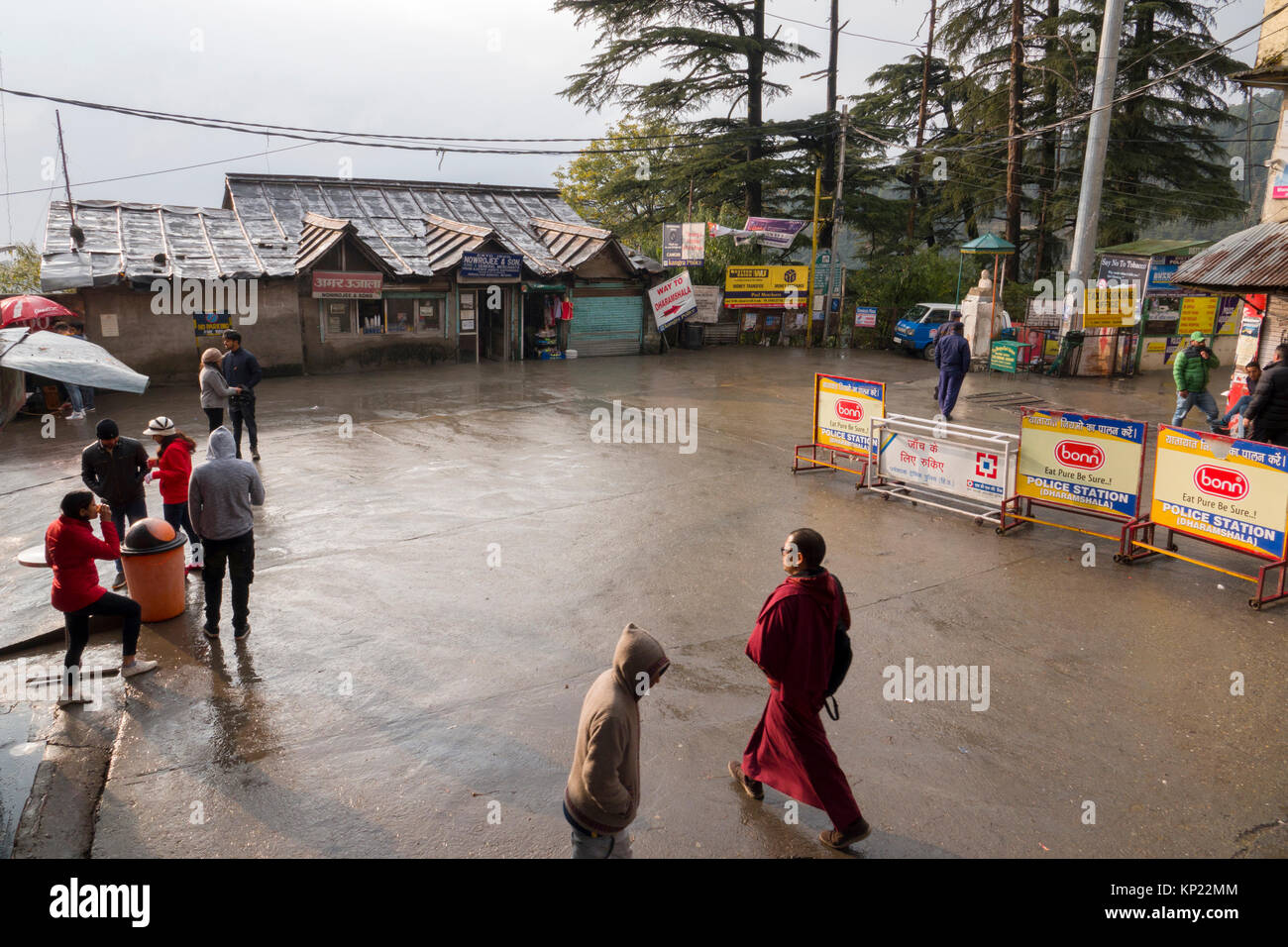 Buddhist monks walk through the main chowk in Mcleod Ganj, India - Stock Image