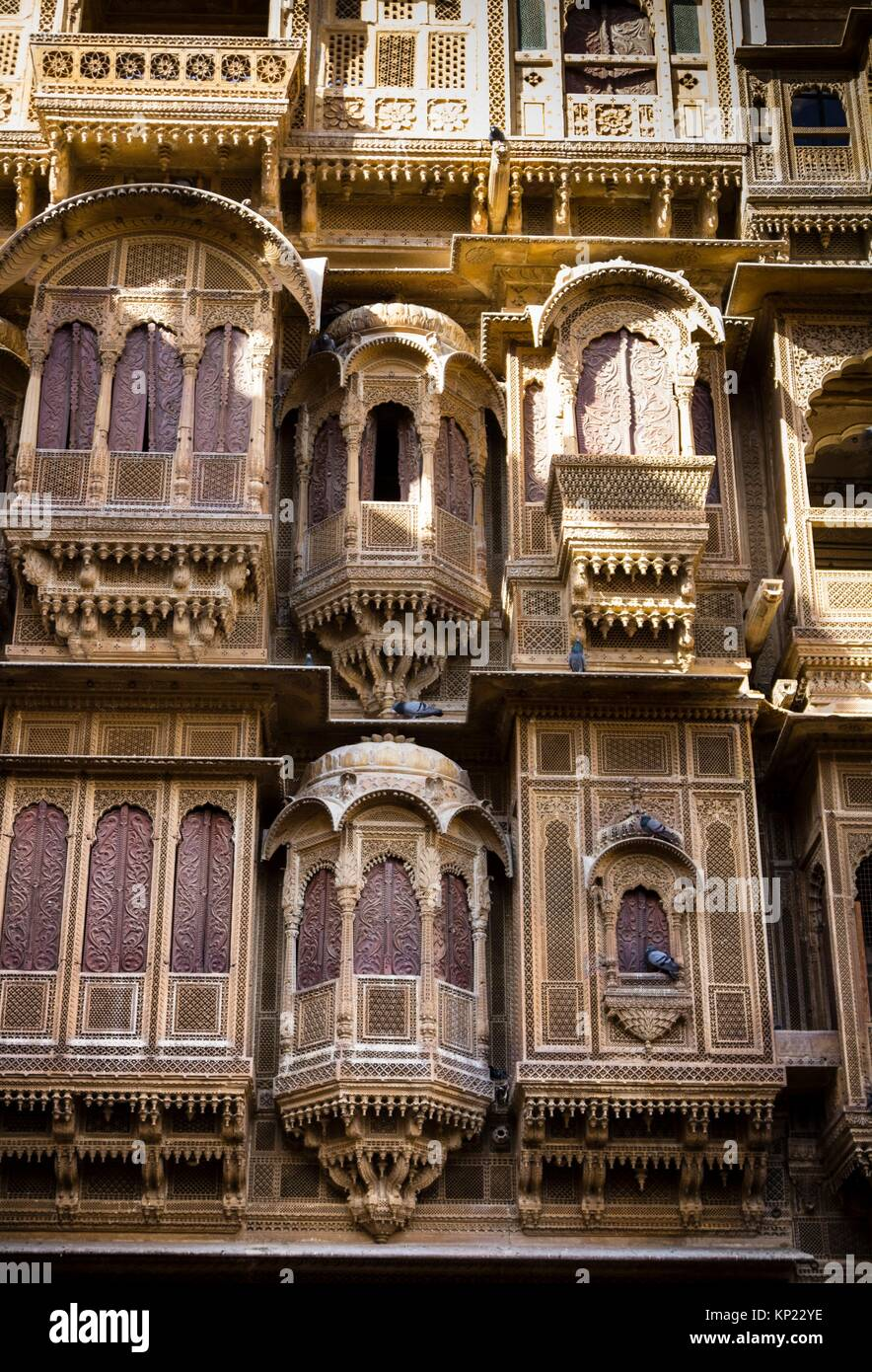 The ostentatious carvings etched out in sandstone with infinite detail and then painstakingly pieced together in - Stock Image