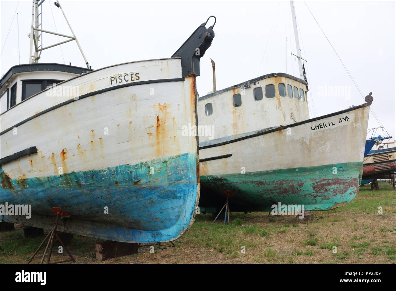 Old weathered boats have seen better days in Crescent City, California. USA - Stock Image