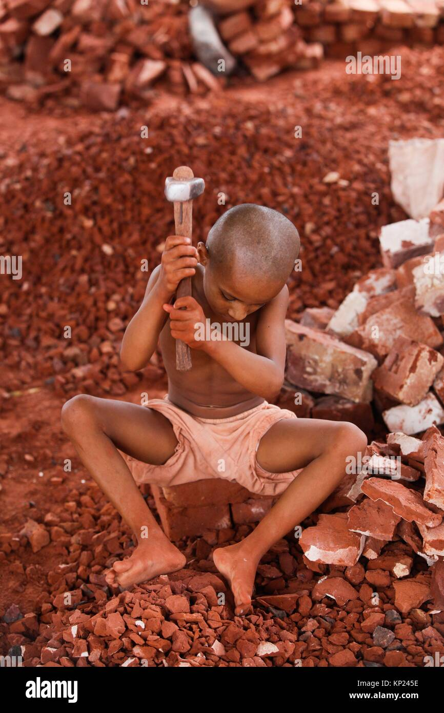 Bangladeshi Child labor break bricks at Postogola brick breaking yard in Dhaka, Bangladesh, on June 3, 2017. With - Stock Image
