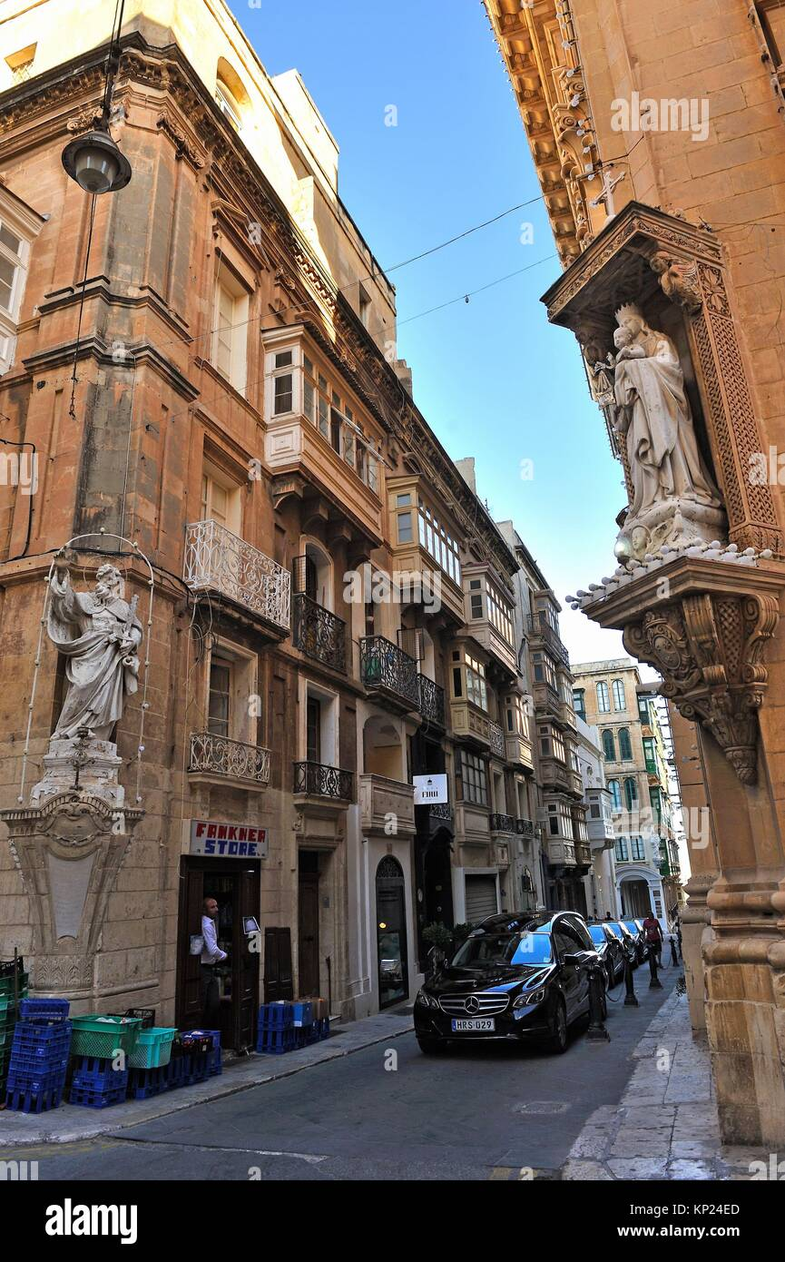 statues of saints at the corner of Old Mint and Old Theatre Streets in Valletta, Malta, Southern Europe. - Stock Image