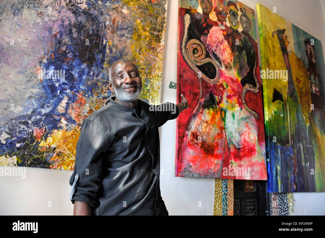 Senegalese artist painter Abdoulaye Diallo in his house and workshop, Ngor island, Dakar, Senegal, West Africa. - Stock Image