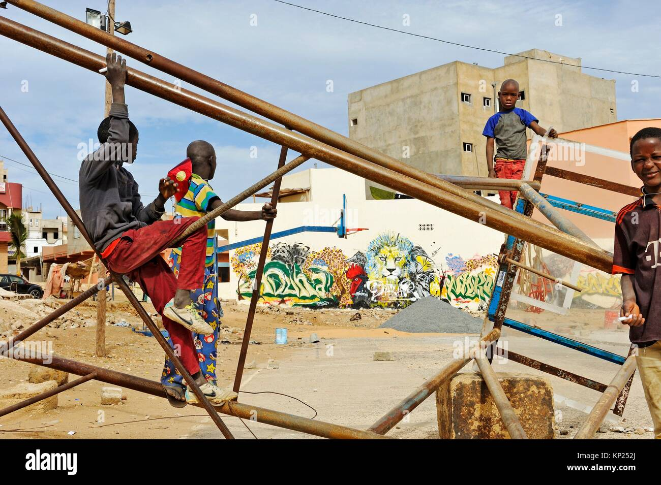 preteens playing in a vacant lot of Ouakam district, Dakar, Senegal, West Africa. - Stock Image
