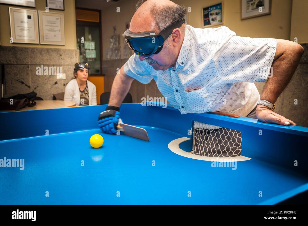 Blind people playing showdown game. Showdown is a fast-moving sport originally designed for people with a visual - Stock Image